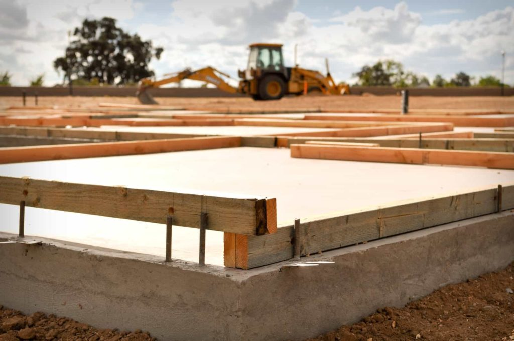 Concrete foundation is being constructed using beam and nails for commercial construction site
