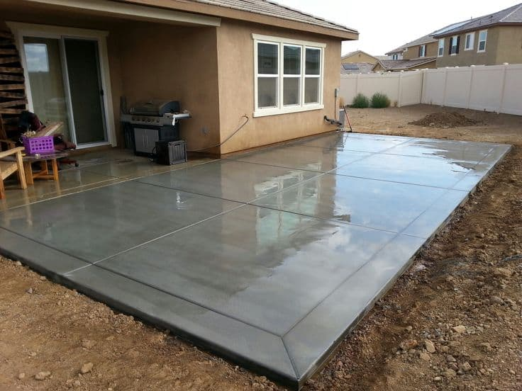 Refinishing concrete constructed patio of a house courtyard using water